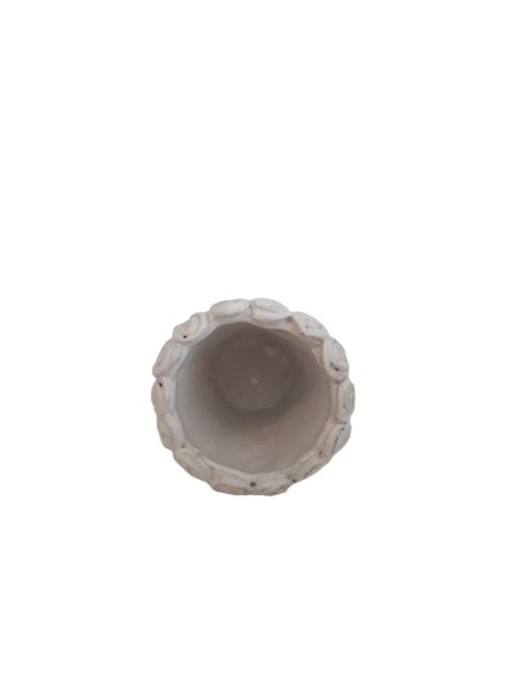Söt liten handgjord vit kruka i keramik.