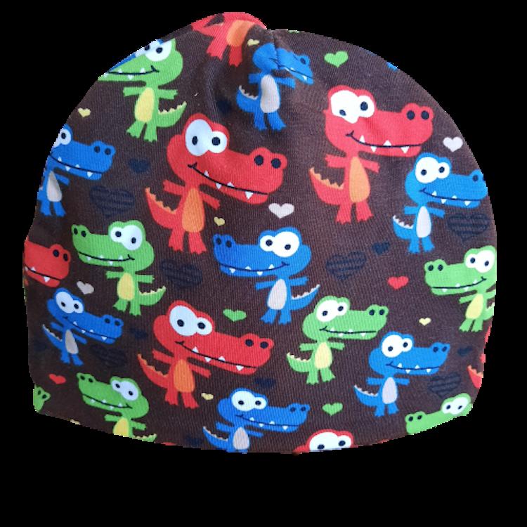 Lilla Täppan Barnmössa med färgglada dinosar