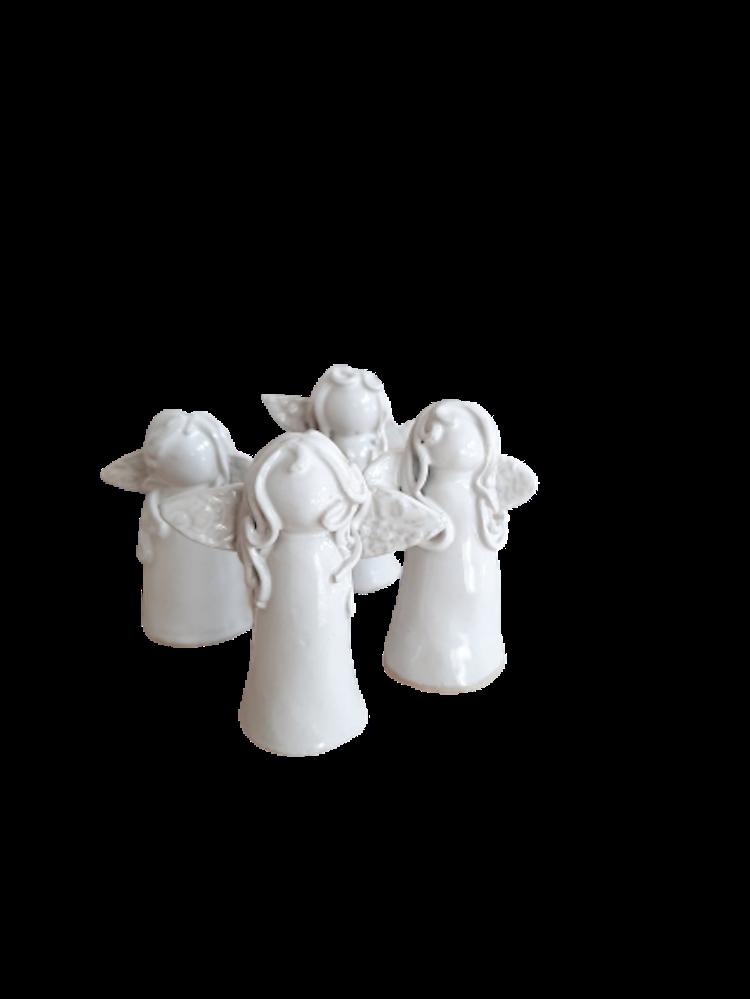 Lilla Täppan vita kramikänglar som ljussläckare.
