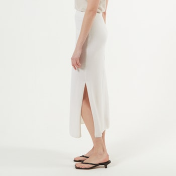 CICCI. Calf-length skirt with slit. White.