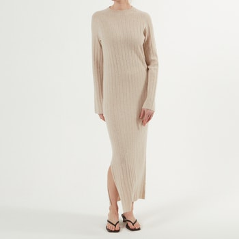 NICOLA. Full length dress with slit. Beige.